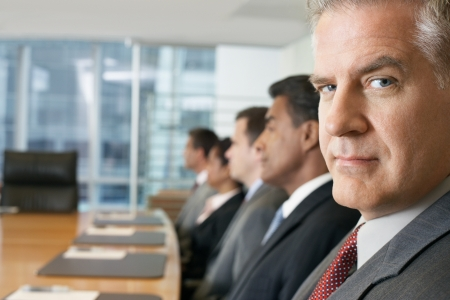 one person with others: Businessman at conference meeting portrait