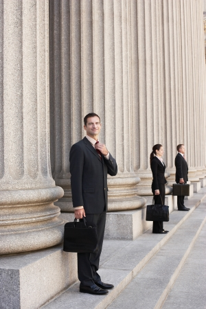 law business: Attorneys waiting on courthouse steps LANG_EVOIMAGES