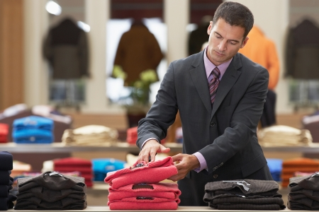clothing store: Businessman shopping in clothes store