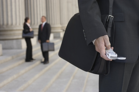 white collar crime: Businessmen Using Cell Phone and People Talking in Background