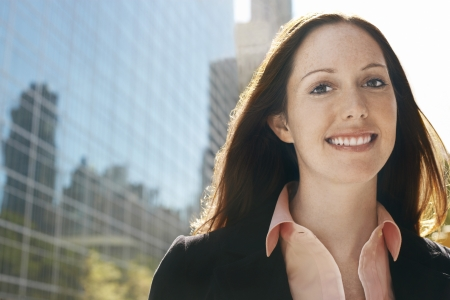 Young woman by office building portrait Stock Photo - 19075954