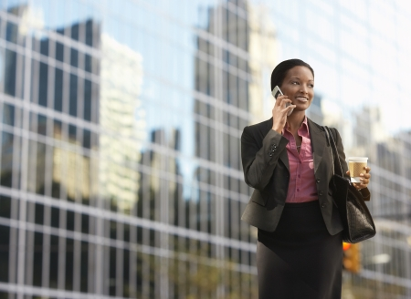 Businesswoman using mobile phone outside office building Stock Photo - 19108278