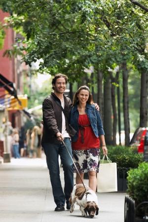 only 2 people: Couple Walking Dog on City Sidewalk LANG_EVOIMAGES