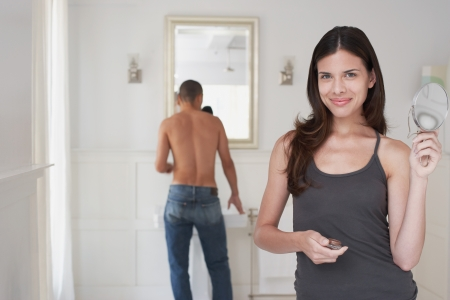 Woman and Man Getting Ready in Bathroom Stock Photo - 18885202