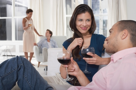 racially diverse: Couples at a Party LANG_EVOIMAGES