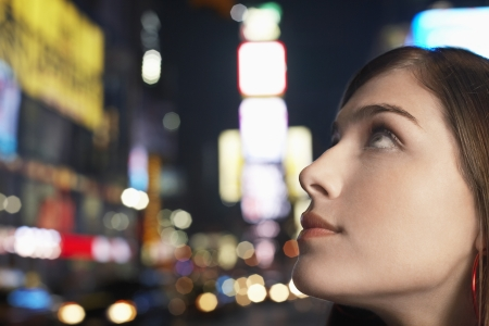 nighttimes: Young Woman on Nighttimes City Street close up profile LANG_EVOIMAGES