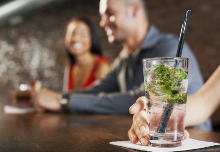 mingle: Woman Holding Cocktail