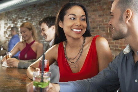 racially diverse: Couples Sitting at Bar