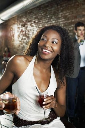 conversational: Woman Sitting at Bar LANG_EVOIMAGES