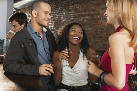 Friends Socializing at Bar Stock Photo - 18886412