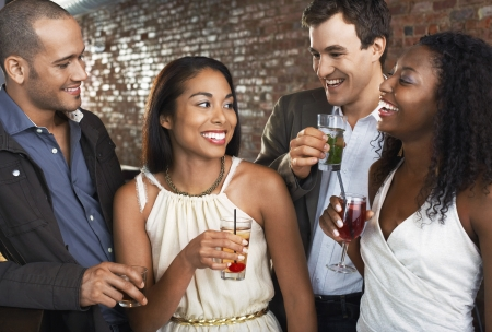 racially diverse: Couples Talking in Bar