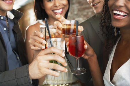 ethnic mix: Friends Toasting at Bar