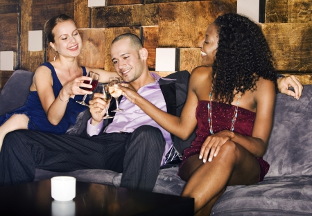 One Man and Two Women Lounging at Bar Stock Photo - 18886734