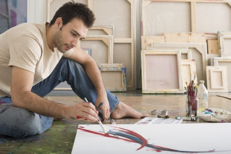 age 25 30 years: Artist Working on Canvas on Floor of Studio