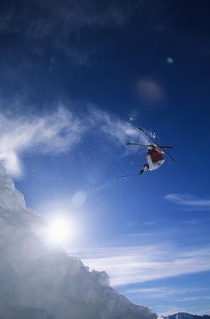 ski goggles: Skier performing flip on mountain LANG_EVOIMAGES