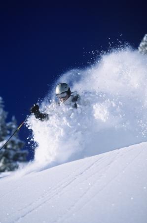 deep powder snow: Skier in deep powder snow LANG_EVOIMAGES