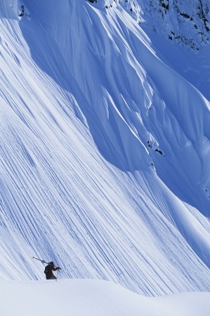 elevated view: Skier on mountain slope elevated view LANG_EVOIMAGES