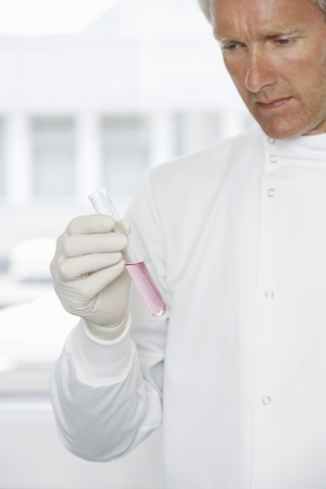 cropped out: Man in Laboratory LANG_EVOIMAGES
