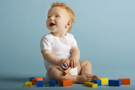 ginger haired: Redheaded Baby Playing With Blocks