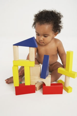 hair blacks: Baby Playing with Building Blocks LANG_EVOIMAGES