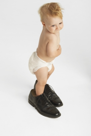 Baby Standing in Mans Shoes