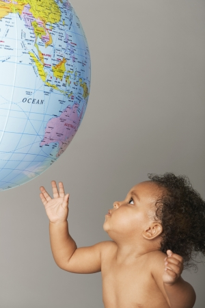 world at your fingertips: Baby Looking at Globe