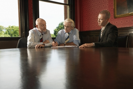 one on one meeting: Two Older Men and One Younger Man in Meeting