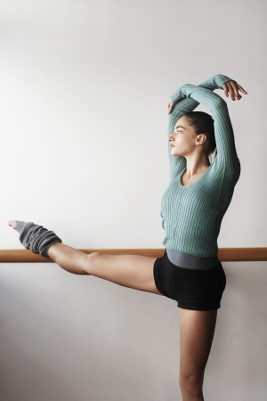 ballet bar: Ballet Dancer Stretching at bar LANG_EVOIMAGES