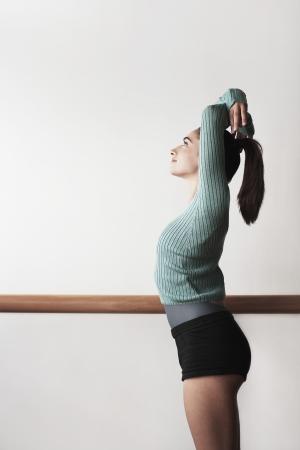 ballet bar: Ballet Dancer with arms overhead at bar LANG_EVOIMAGES