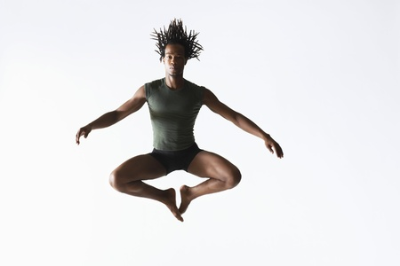 midair: Ballet dancer leaping in mid-air LANG_EVOIMAGES