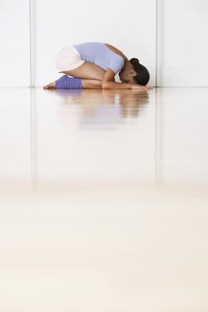 leg warmers: Dancer crouching in prayer position