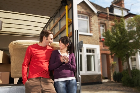 Couple Leaning On Back of Removals Van Stock Photo
