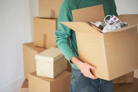 unpacking: Man Carrying open Cardboard Box