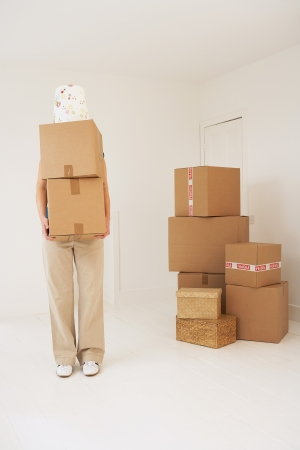 unknown age: Person carrying moving boxes
