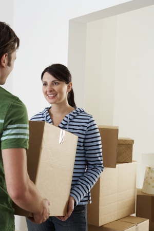 mundane: Young Couple Moving into New Home