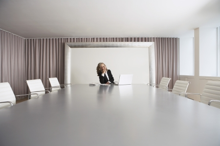 early 40s: Business Executive Using Laptop in Conference Room