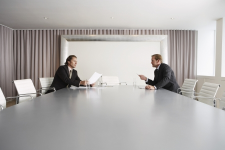 two persons only: Businessmen Discussing Plans in Conference Room