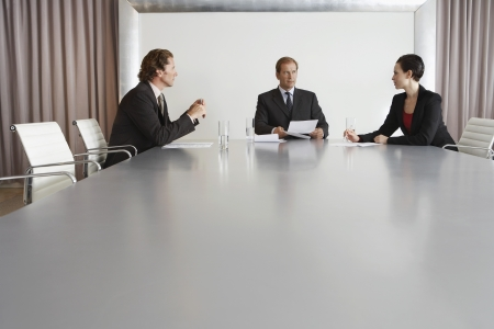 strategical: Businesspeople Meeting in Conference Room