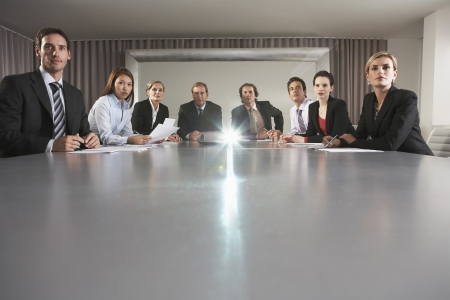 Businesspeople Watching Presentation in Conference Room LANG_EVOIMAGES