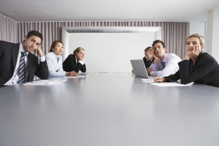 jaded: Bored Businesspeople Sitting in Conference Room