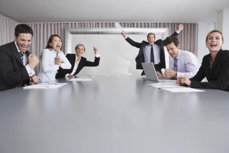Businesspeople Celebrating Good News Stock Photo