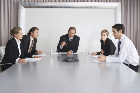 Businesspeople Listening During Teleconference LANG_EVOIMAGES