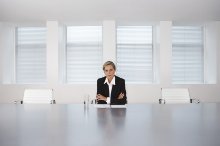 decisionmaking: Business Executive Sitting in Boardroom LANG_EVOIMAGES