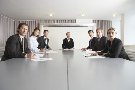 intimidating: Businesspeople at Conference Table