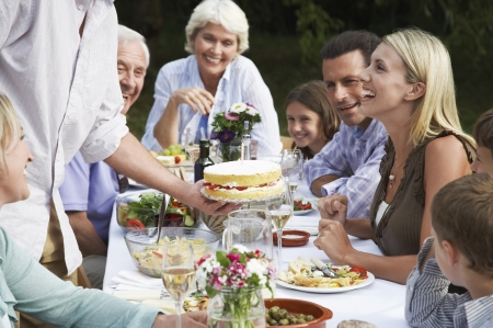late fifties: Cake Being Served at Family Picnic