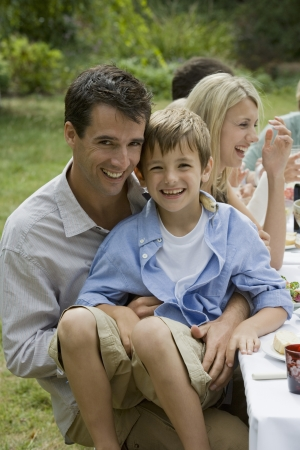 10 to 12 year olds: Father Holding Son at Family Picnic