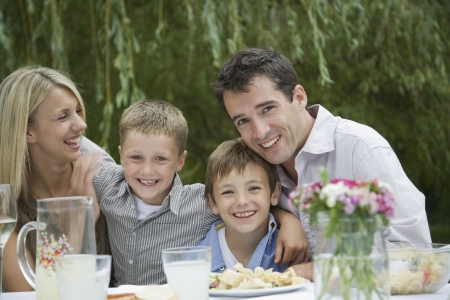 10 to 12 year olds: Family Having Picnic in Park