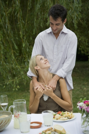 30 to 35 year olds: Couple Eating Outdoors