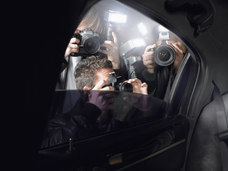 Paparazzi Shooting Inside a Limousine Stock Photo