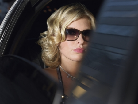 celebrity: Female Star Inside Limousine